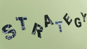 Strategy word on the wall. The word STRATEGY on a light green wall stock video
