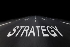 Strategy written on asphalt Stock Photos
