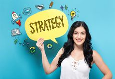 Strategy with woman holding a speech bubble. Strategy with young woman holding a speech bubble stock photos