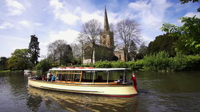 Stratford Upon Avon, England. May,4th,2015 : Boat trip beside the Holy Trinity Church, buried site of William Shakespeare and the Royal Shakespeare theatre on stock footage