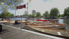 Stratford Upon Avon, England. MAY,4th,2015 : Boats for hire beside the Royal Shakespeare theatre on the River Avon stock video footage