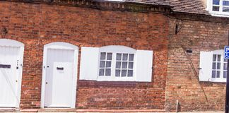 Facade of the vintage british building at the center of old town. Royalty Free Stock Images
