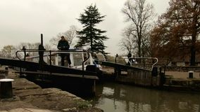 Stratford Upon Avon, UK - 26 November 2018 - Narrowboat Navigates Grand Union Canal Lock In Shakespeare`s Town stock video