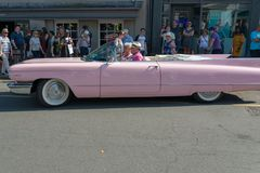 Side view of pink cadillac on busy english street during motoring festival Royalty Free Stock Images