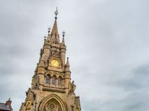 Stratford clock tower. Clock tower at central square of Stratford upon Avon city in England, the memorial architecture from America, under twilight cloudy sky Royalty Free Stock Images