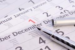 Strati del calendario con la penna Immagine Stock Libera da Diritti