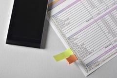 Strati del documento di lavoro e del telefono Fotografia Stock Libera da Diritti