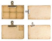 Strati di carta invecchiati con la clip del metallo isolata su bianco Immagini Stock Libere da Diritti