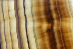 Stratified brown superior natural stone material Royalty Free Stock Image