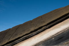 Stratified, striped rocks  , colored  stone sediment. Stratified, striped rocks   - colored  stone sediment Stock Photography