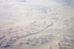 Stratigraphy in snow. Aerial view of folded stratigraphy in snow Mongolia Stock Images