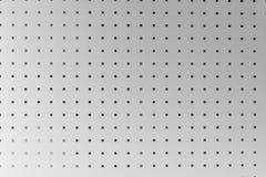 Strato di alluminio perforato d'argento, fondo Immagini Stock