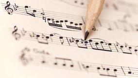 Strato di musica con la matita Fotografie Stock Libere da Diritti