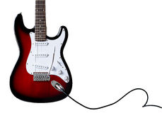 A stratocaster model electric guitar with cable Royalty Free Stock Photos