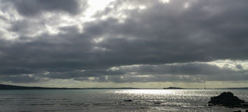 Stratocumulus cloud, Auckland Harbour. Royalty Free Stock Photo