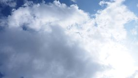 Stratocumulus cloud on the sky under the sunshine. Background of landscape nature abstract white and blue stock photo