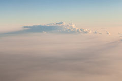 Stratosphere. A sea of clouds seen from above while flying in a commercial airplane Stock Image