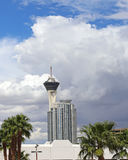 The Stratosphere tower. Cloudy sky with modern building and the Stratosphere hotel and casino tower in Las Vegas Stock Photos