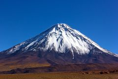 Stratovolcano Licancabur with its characteristic snow peak in Atacama Desert, Chile. Stock Photos