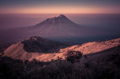Stratovolcano Mt. Merbabu during sunrise Royalty Free Stock Photos