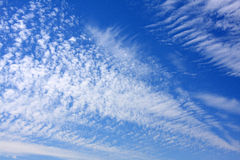 Stratus. Wispy stratus clouds streaked across a midday sky stock photo