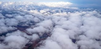 Stratus cloud over sky view from airplane. Stratus clouds above ground view from airplane. underneath the sky is the field Royalty Free Stock Images