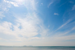 Stratus clouds in blue sky. Under calm sea Royalty Free Stock Photo