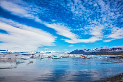 Stratus clouds are reflected in the surface of water Stock Photo