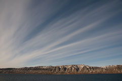 Stratus Clouds - Scoresby Sound - Greenland. Stratus Clouds in Scoresby Sound - Greenland Stock Image