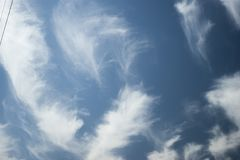 Stratus floccus Clouds. In the middle of the day on the sky royalty free stock images