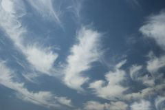 Stratus floccus Clouds. In the middle of the day on the sky stock photography