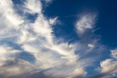 Stratus type clouds before sunset stock photos