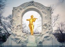 Strauss in snowstorm. Statue of Johann Strauss in Vienna Stadtpark Royalty Free Stock Photo