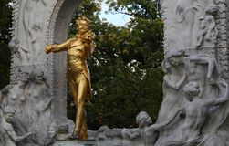 Strauss Statue in Vienna, Austria, Wien. Music, Composer. Golden Statue. Monument to Johann Strauss II. Am Stadtpark, 1030 Wien, Austria. Music, Composer royalty free stock photo