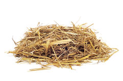 Straw. A pile of straw on a white background Stock Photos