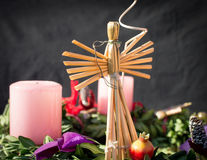 Straw Angel on an advent wreath Stock Image