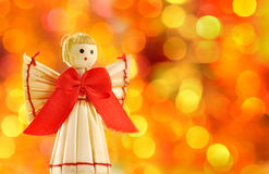 Straw angel on the background lights defocus Royalty Free Stock Image