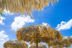 Straw awning on the beach. Straw awning on a beach with a blue sky. Aruba, caribbean beach stock photos