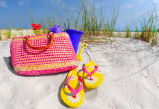 Straw bag and accessories on sand dune Stock Images