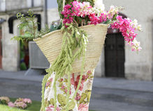 Straw bag with flowers Stock Photos