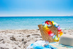 Straw bag and hat on the beach Royalty Free Stock Photo