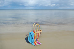 Straw bag on a sand. Royalty Free Stock Photography