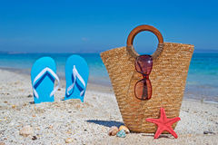 Straw bag on then sand Stock Images