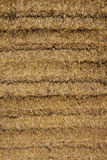 Straw bale background. A background image of newly harvested straw with a golden color Royalty Free Stock Images