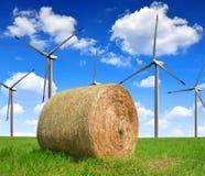 Straw bale. On farmland with wind turbines Royalty Free Stock Photo