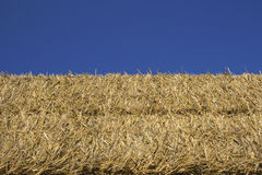 Straw bale. Silhouetted over the blue sky Royalty Free Stock Images