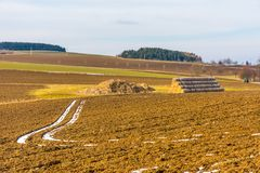 Straw bales on the agriculture field. Farming on the typical countryside land. Straw bales on the agriculture field. Farming on the typical countryside land Royalty Free Stock Photos
