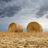 Straw bales on farmland Storm clouds. Stock Image