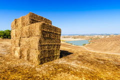 Straw bales and lake in Tuscany, italy Royalty Free Stock Photography