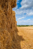 Straw bales over mown field, cloud cover Royalty Free Stock Photos